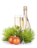 Champagne glasses, bottle, baubles and fir tree — Stockfoto