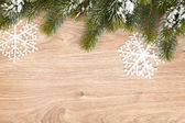 Christmas fir tree on wooden board — Foto Stock
