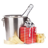 Champagne bottle in bucket and gift boxes — Stock Photo