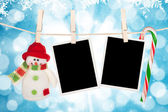 Blank photo frames and snowman hanging on the clothesline — Stock Photo