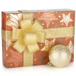 Gift box with ribbon, bow and christmas decor — Stock Photo
