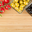 Olives, tomatoes and basil on cutting board — Stock Photo