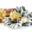 Gift boxes and christmas decor with snowy fir tree — Zdjęcie stockowe