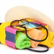 Stock Photo: Bag with towels, sunglasses and hat