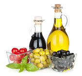 Olives, tomatoes, herbs and condiments — Stock Photo