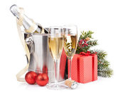 Christmas champagne in bucket and gift box — Stock Photo