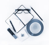 Coffee cup and office supplies — Stock Photo