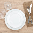 Empty plate, wine glasses and silverware set — Stock Photo
