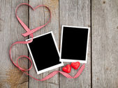 Photo frames and candy hearts — Stock Photo