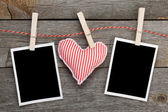 Blank photos and red heart — Stock Photo