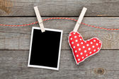 Blank photo and red heart — Stock Photo