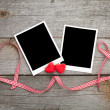 Photo frames with red ribbon — Stock Photo