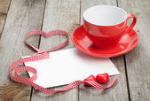 Blank greeting card and coffee cup — Stock Photo