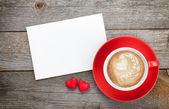 Blank greeting card and red coffee cup — Stock Photo