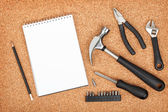 Set of tools on cork background — 图库照片