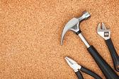 Set of tools on cork background — Photo