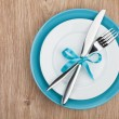 Fork with knife over plates — Stock Photo #39132007