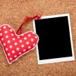 Blank instant photo and red heart — Stock Photo