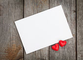 Valentine's day blank gift card and red candy hearts — Stock Photo