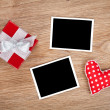 Blank photo frames and small red gift box — Stock Photo #39570097