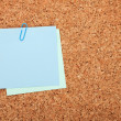 Blank postit note on cork notice board — Stock Photo
