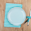 Fork with knife, blank plates and napkin — Stock Photo