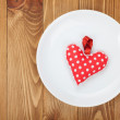Valentine's Day toy heart over plate — Stock Photo #39570319