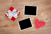 Blank photo frames and small red gift box — Stock Photo