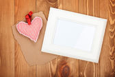 Blank photo frame and red Valentine's day heart toy — Stock Photo