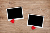 Two photo frames and small red candy hearts — Stock Photo