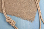 Ship rope on old wooden texture background — Stock Photo