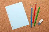 Blank notepad page on cork notice board — Stock Photo