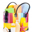 Bag with towels, sunglasses and beach items — Stock Photo