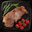 Stock Photo: Sirloin steak with rosemary and cherry tomatoes
