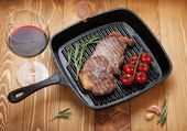 Sirloin steak with rosemary and cherry tomatoes — Stock Photo
