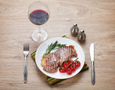 Sirloin steak with rosemary — Stock Photo