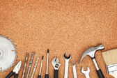 Set of tools on cork background — Stok fotoğraf