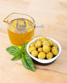 Olives, olive oil and basil — Stock Photo