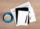 Blank notepad and coffee cup — Stock Photo
