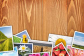 Stack of printed pictures collage — Stockfoto