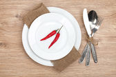 Red chili peppers on plate — Stock Photo