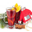 Christmas mulled wine with spices and snowy fir tree — Stock Photo