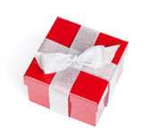 Red gift box with silver ribbon — Stock Photo