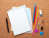 Blank notepad on cork notice board — Stock Photo