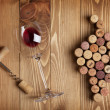 Red wine glass, corkscrew and grape shaped corks — Stock Photo