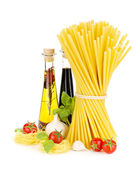 Pasta, tomatoes, basil, olive oil, vinegar, garlic and parmesan — Stock Photo