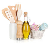 Kitchen utensils in holder and condiments — Stock Photo