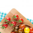 Colorful cherry tomatoes on cutting board — Stock Photo #42749235