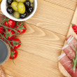 Red wine with olives, tomatoes, prosciutto, bread and spices — Stock Photo
