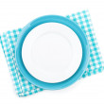 Empty plates over kitchen towel — Stock Photo #42749415